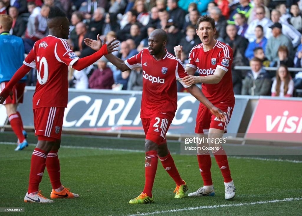 West Bromwich Albion goalscorer Youssouf Mulumbu (C) celebrates his goal with Thievy Bifouma and <a gi-track='captionPersonalityLinkClicked' href=/galleries/search?phrase=Zoltan+Gera&family=editorial&specificpeople=216370 ng-click='$event.stopPropagation()'>Zoltan Gera</a> (R) during the Barclays Premier League match between Swansea City and West Bromwich Albion at The Liberty Stadium on March 15, 2014 in Swansea, Wales.