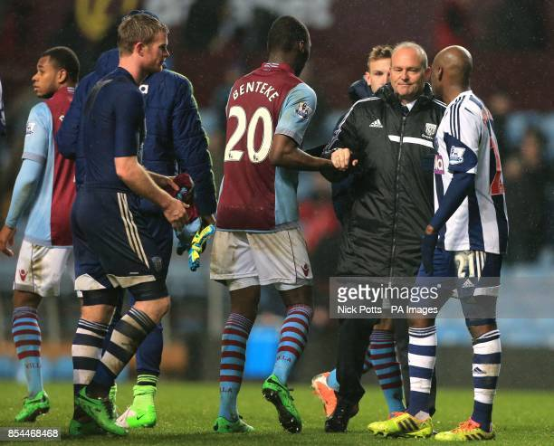 West Bromwich Albion Head Coach Pepe Mel shows his dejection as he shakes the hand of Aston Villa's Christian Benteke who scored the the winning goal...