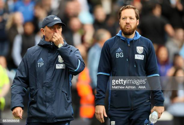 West Bromwich Albion Head Coach Tony Pulis and Assisatnt Head Coach Ben Garner look on prior to the Premier League match between Manchester City and...
