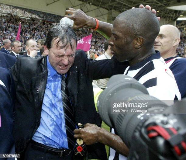 West Bromwich Albion manager Bryan Robson is drenched by player Kevin Campbell