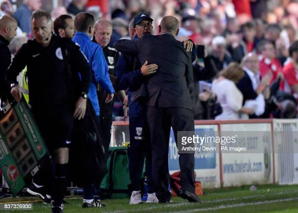 West Bromwich Albion manager Tony Pulis hugs Accrington Stanley manager John Coleman during the Carabao Cup Second Round match at the Wham Stadium...