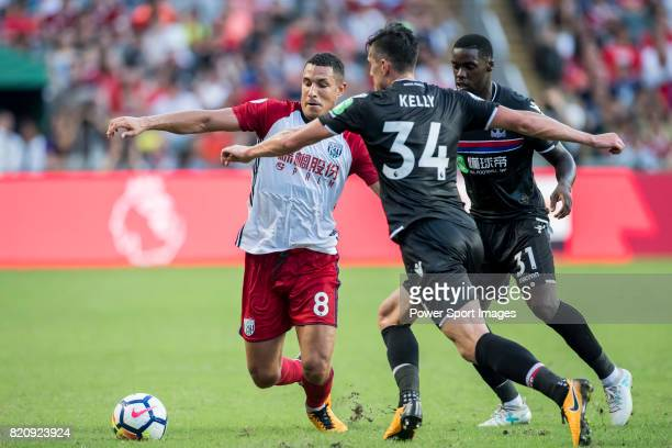 West Bromwich Albion midfielder Jake Livermore competes for the ball with Crystal Palace players Martin Kelly and Jeffrey Schlupp during the Premier...