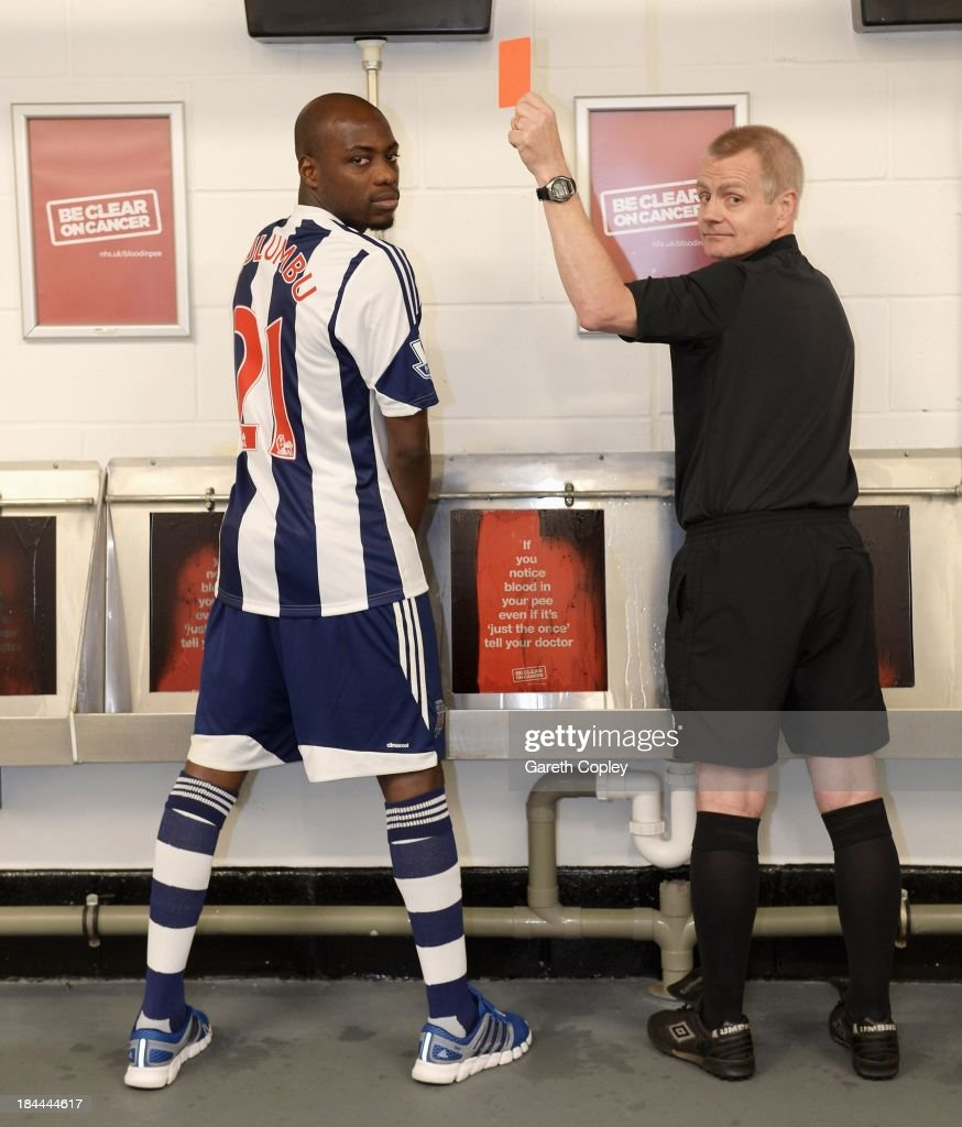 West Bromwich Albion midfielder Youssouf Mulumbu helps show bladder and kidney cancer the red card by supporting the new Be Clear on Cancer campaign to raise awareness of blood in pee as a key symptom at The Hawthorns on October 11, 2013 in West Bromwich, England. The club is supporting the new Be Clear on Cancer campaign launching today Tuesday October 15, 2013.