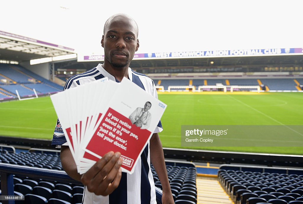 West Bromwich Albion midfielder Youssouf Mulumbu supports the Be Clear on Cancer campaign launching today to raise awareness of the signs and symptoms of bladder and kidney cancer at The Hawthorns on October 11, 2013 in West Bromwich, England. The club is supporting the new Be Clear on Cancer campaign launching today Tuesday October 15, 2013.