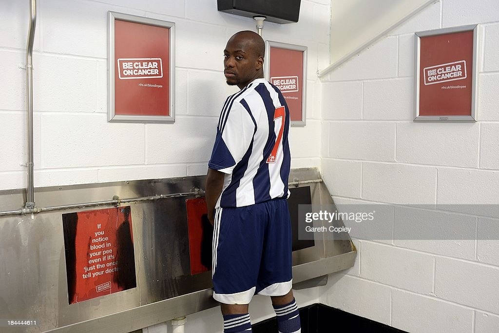 West Bromwich Albion midfielder Youssouf Mulumbu tries the club's new heat reactive urinals while swapping his 21 shirt for a number 7 - the percentage increase in kidney cancer mortality rates over the last ten years on October 11, 2013 in West Bromwich, England. West Bromwich midfielder Youseff Mulumbu supports the Be Clear on Cancer campaign launching today to raise awareness of the signs and symptoms of bladder and kidney cancer.