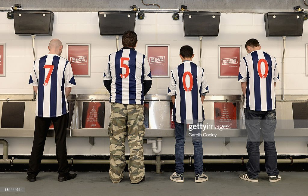 West Bromwich Albion supporters try out new heat reactive urinals at the club while reminding people that around 7500 people die from bladder and kidney cancer each year in England at The Hawthorns on October 11, 2013 in West Bromwich, England. The club is supporting the new Be Clear on Cancer campaign launching today Tuesday October 15, 2013.