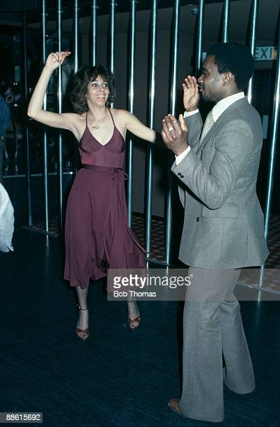 West Bromwich Albion winger Laurie Cunningham dancing with Helen Scott a singer with the Three Degrees at the Holy City Zoo nightclub in Birmingham...