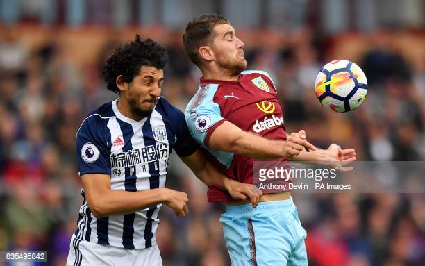 West Bromwich Albion's Ahmed Hegazy and Burnley's Sam Vokes battle for the ball during the Premier League match at Turf Moor Burnley