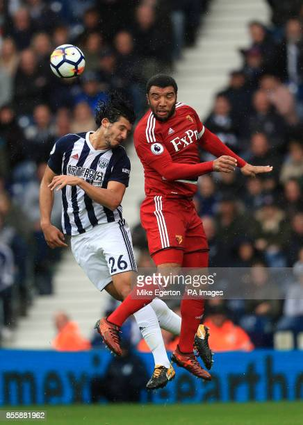 West Bromwich Albion's Ahmed Hegazy and Watford's Troy Deeney battle for the ball during the Premier League match at The Hawthorns West Bromwich