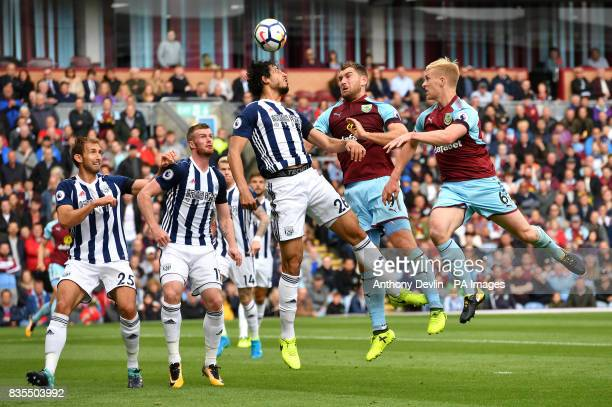 West Bromwich Albion's Ahmed Hegazy clears away from Burnley's Sam Vokes and Ben Mee during the Premier League match at Turf Moor Burnley
