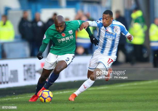 West Bromwich Albion's Allan Nyom and Huddersfield Town's Rajiv van La Parra battle for the ballduring the Premier League match at the John Smith's...