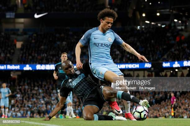 West Bromwich Albion's Allan Nyom left0 and Manchester City's Leroy Sane battle for the ball during the Premier League match at the Etihad Stadium...