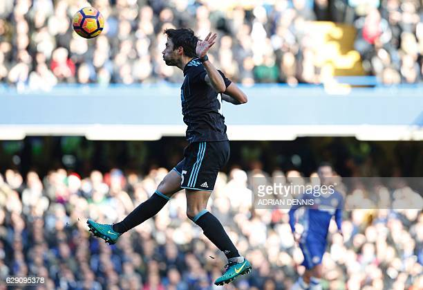 TOPSHOT West Bromwich Albion's Argentinian midfielder Claudio Yacob heads the ball during the English Premier League football match between Chelsea...