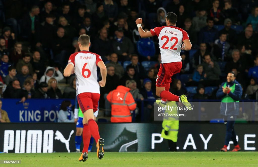 West Bromwich Albion's Belgian midfielder Nacer Chadli (R) celebrates scoring his team's first goal during the English Premier League football match between Leicester City and West Bromwich Albion at King Power Stadium in Leicester, central England on Octopber 16, 2017. / AFP PHOTO / Lindsey PARNABY / RESTRICTED TO EDITORIAL USE. No use with unauthorized audio, video, data, fixture lists, club/league logos or 'live' services. Online in-match use limited to 75 images, no video emulation. No use in betting, games or single club/league/player publications. /