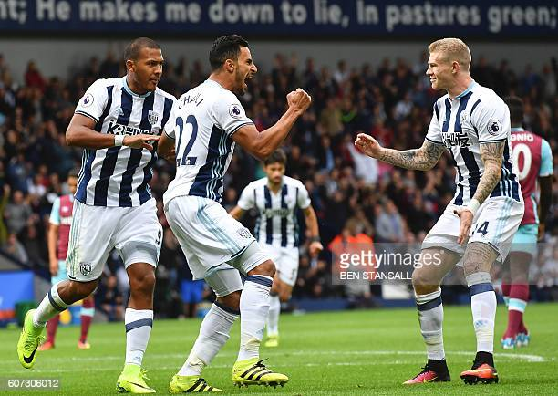 West Bromwich Albion's Belgian midfielder Nacer Chadli celebrates with Irish midfielder James McClean after scoring a penalty for the opening goal...