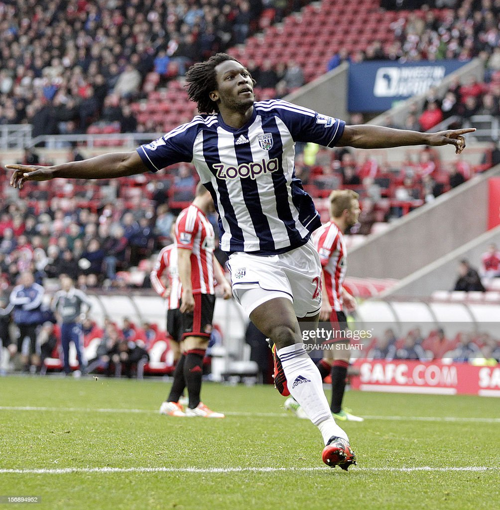 """West Bromwich Albion's Belgian striker Romelu Lukaku celebrates scoring his team's third goal against Sunderland during their English Premier League football match at the Stadium of Light in Sunderland, north-east England, on November 24, 2012. USE. No use with unauthorized audio, video, data, fixture lists, club/league logos or """"live"""" services. Online in-match use limited to 45 images, no video emulation. No use in betting, games or single club/league/player publications"""