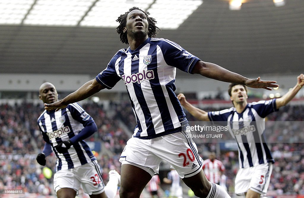 "West Bromwich Albion's Belgian striker Romelu Lukaku (C) celebrates scoring their third goal against Sunderland during their English Premier League football match at the Stadium of Light in Sunderland, north-east England, on November 24, 2012. AFP PHOTO/GRAHAM STUART USE. No use with unauthorized audio, video, data, fixture lists, club/league logos or ""live"" services. Online in-match use limited to 45 images, no video emulation. No use in betting, games or single club/league/player publications"