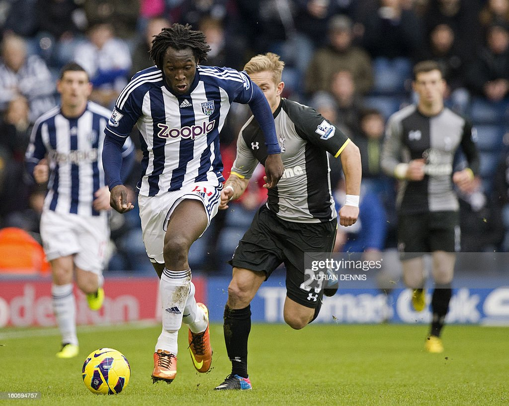 """West Bromwich Albion's Belgian striker Romelu Lukaku (L) runs with the ball chased by Tottenham Hotspur's German midfielder Lewis Holtby (R) during the English Premier League football match between West Bromwich Albion and Tottenham Hotspur at The Hawthorns in West Bromwich, West Midlands, England on February 3, 2013. USE. No use with unauthorized audio, video, data, fixture lists, club/league logos or """"live"""" services. Online in-match use limited to 45 images, no video emulation. No use in betting, games or single club/league/player publications."""