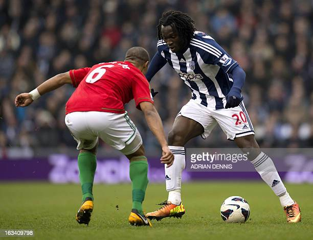 West Bromwich Albion's Belgian striker Romelu Lukaku vies for the ball against Swansea City's Ashley Williams during the English Premier League...