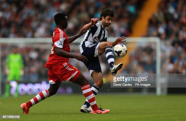 West Bromwich Albion's Claudio Yacob and Southampton's Victor Wanyama battle for the ball