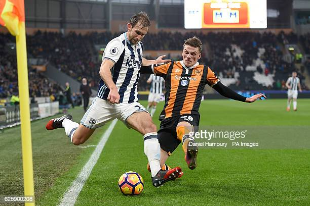 West Bromwich Albion's Craig Dawson and Hull City's Josh Tymon battle for the ball during the Premier League match at the KCOM Stadium Hull