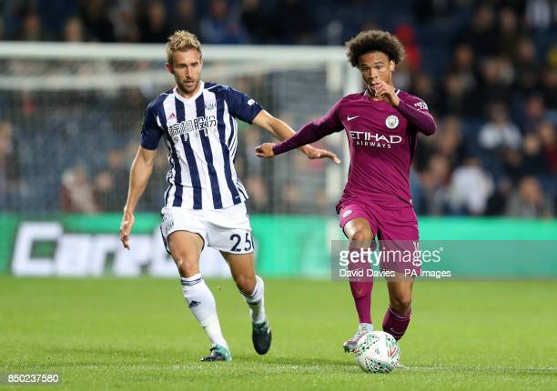 West Bromwich Albion's Craig Dawson and Manchester City's Leroy Sane battle for the ball during the Carabao Cup Third Round match at The Hawthorns...