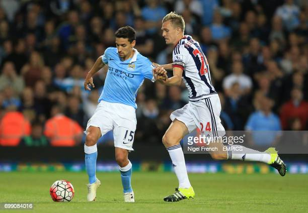 West Bromwich Albion's Darren Fletcher and Manchester City's Jesus Navas battle for the ball