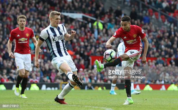 West Bromwich Albion's Darren Fletcher and Manchester United's Jesse Lingard in action during the Premier League match at Old Trafford Manchester