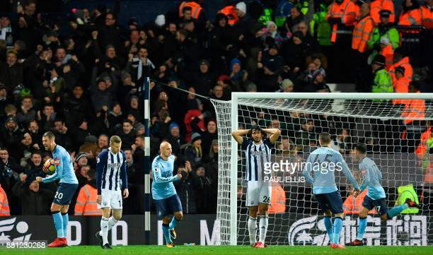 West Bromwich Albion's Egyptian defender Ahmed Hegazy and West Bromwich Albion's Irish midfielder James McClean react after West Brom's equalising...