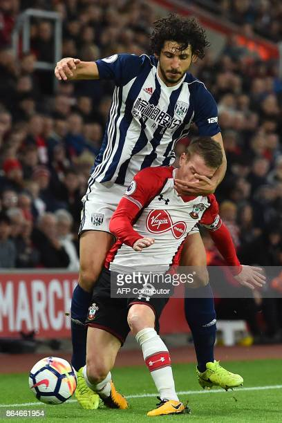 West Bromwich Albion's Egyptian defender Ahmed Hegazy vies with Southampton's Northern Irish midfielder Steven Davis during the English Premier...