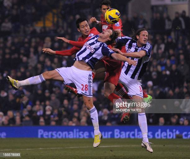 West Bromwich Albion's English defender Billy Jones and West Bromwich Albion's Swedish defender Jonas Olsson vie with Southampton's Japanese defender...