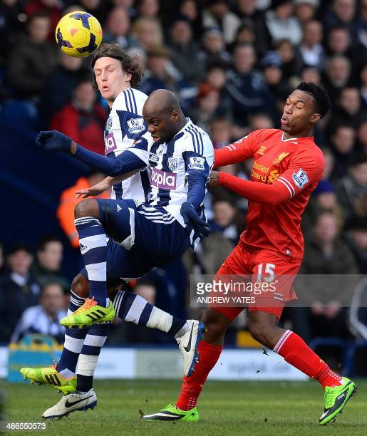 West Bromwich Albion's English defender Billy Jones and West Bromwich Albion's Congolese defender Youssuf Mulumbu vie with Liverpool's English...