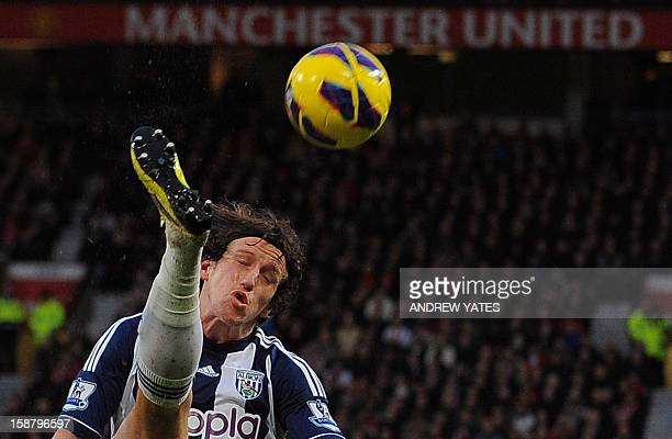 West Bromwich Albion's English defender Billy Jones clears the ball during the English Premier League football match between Manchester United and...