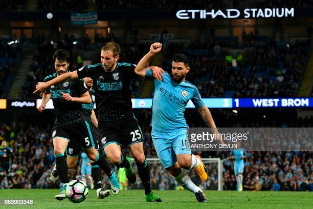 West Bromwich Albion's English defender Craig Dawson holds off Manchester City's Argentinian striker Sergio Aguero during the English Premier League...