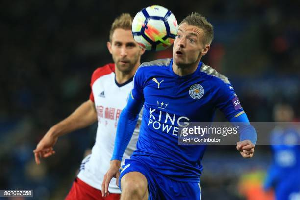 West Bromwich Albion's English defender Craig Dawson vies with Leicester City's English striker Jamie Vardy during the English Premier League...