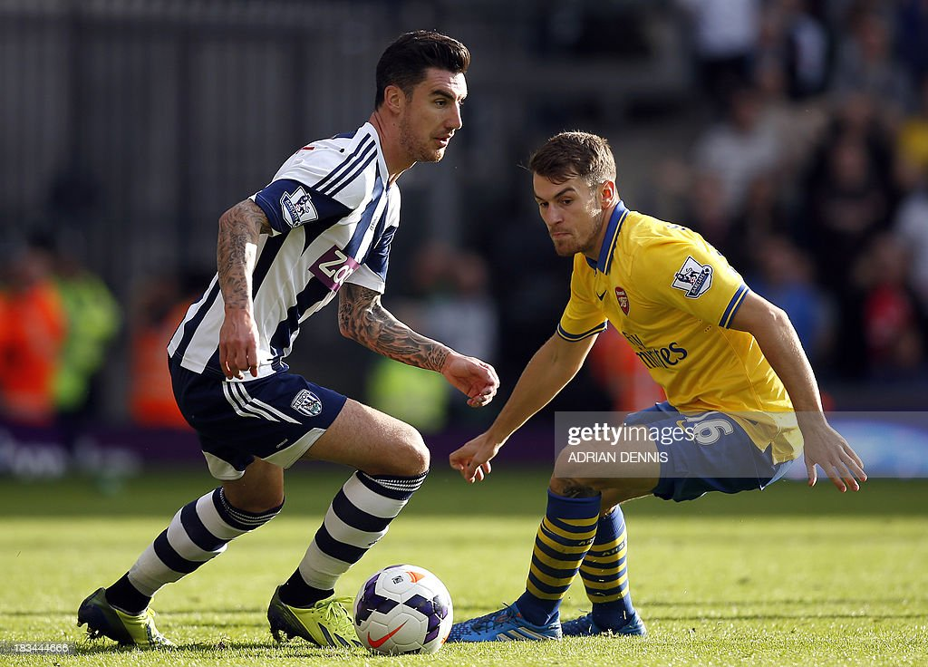 West Bromwich Albion's English defender Liam Ridgewell (L) vies for the ball against Arsenal's Welsh midfielder Aaron Ramsey (R) during the English Premier League football match between West Bromwich Albion and Arsenal at The Hawthorns in West Bromwich on October 6, 2013. The match ended with a 1-1 score.