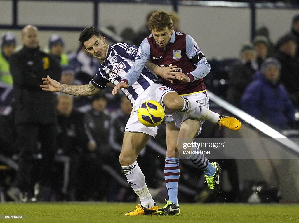 """West Bromwich Albion's English defender Liam Ridgewell (L) vies with Aston Villa's Australian striker Brett Holman during the English Premier League football match between West Bromwich Albion and Aston Villa at The Hawthorns in West Bromwich on January 19, 2013. The match ended in a 2-2 draw. AFP PHOTO/Ian KINGTON - RESTRICTED TO EDITORIAL USE. No use with unauthorized audio, video, data, fixture lists, club/league logos or """"live"""" services. Online in-match use limited to 45 images, no video emulation. No use in betting, games or single club/league/player publications."""