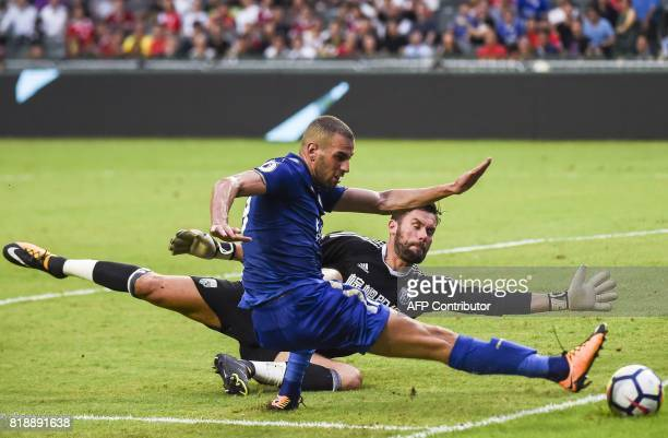 West Bromwich Albion's English goalkeeper Ben Foster blocks a shot on goal by Leicester City's Algerian forward Islam Slimani during the 2017 Premier...