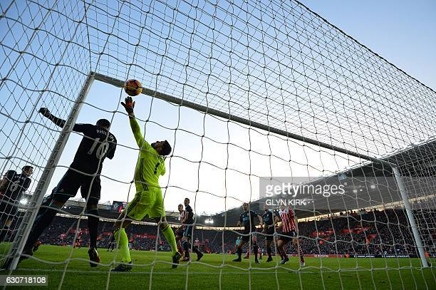 West Bromwich Albion's English goalkeeper Ben Foster dives but fails to save the ball headed into the goal by Southampton's Irish striker Shane Long...