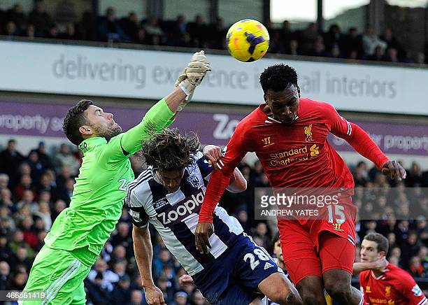 West Bromwich Albion's English goalkeeper Ben Foster punches clear from West Bromwich Albion's English defender Billy Jones and Liverpool's English...