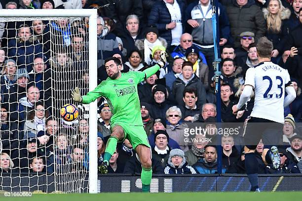 West Bromwich Albion's English goalkeeper Ben Foster reacts as he fails to save a shot from Tottenham Hotspur's English striker Harry Kane resulting...