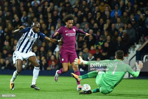 West Bromwich Albion's English goalkeeper Ben Foster saves at the feet of Manchester City's German midfielder Leroy Sane during the English League...