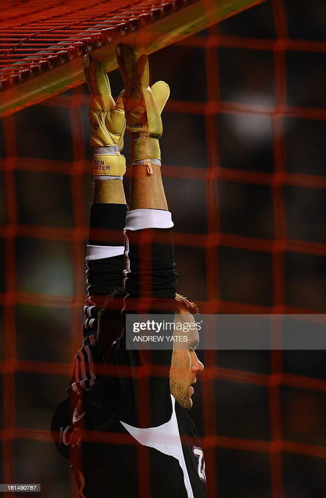 "West Bromwich Albion's English goalkeeper Ben Foster warms up before the English Premier League football match between Liverpool and West Bromwich Albion at Anfield in Liverpool, northwest England on February 11, 2013. West Bromwich won the match 2-0. AFP PHOTO/ANDREW YATES === RESTRICTED TO EDITORIAL USE. No use with unauthorized audio, video, data, fixture lists, club/league logos or ""live"" services. Online in-match use limited to 45 images, no video emulation. No use in betting, games or single club/league/player publications ==="