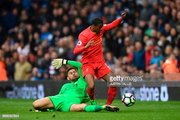 West Bromwich Albion's English goalkeeper Jack Rose chases back to tackle Liverpool's Dutch midfielder Georginio Wijnaldum after going up to attack a...
