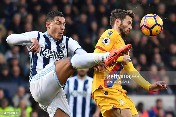 TOPSHOT West Bromwich Albion's English midfielder Jake Livermore vies with Crystal Palace's French midfielder Yohan Cabaye during the English Premier...