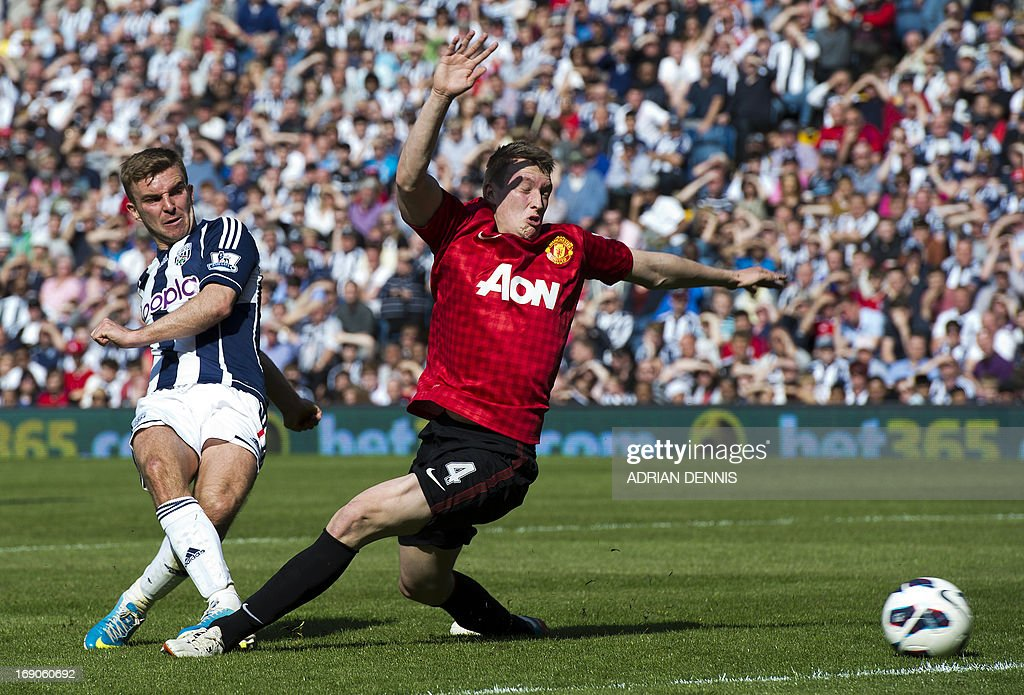 "West Bromwich Albion's English-born Scottish midfielder James Morrison (L) shoots past Manchester United's English defender Phil Jones (R) to score during the English Premier League football match between West Bromwich Albion and Manchester United at The Hawthorns in West Bromwich, central England, on May 19, 2013. English football witnessed the end of an era as Alex Ferguson signed off as Manchester United manager with an extraordinary 5-5 draw at West Bromwich Albion in his 1,500th and final game. USE. No use with unauthorized audio, video, data, fixture lists, club/league logos or ""live"" services. Online in-match use limited to 45 images, no video emulation. No use in betting, games or single club/league/player publications."