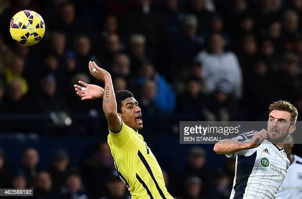West Bromwich Albion's Englishborn Scottish midfielder James Morrison vies for the ball with Tottenham Hotspur's Brazilian midfielder Paulinho during...
