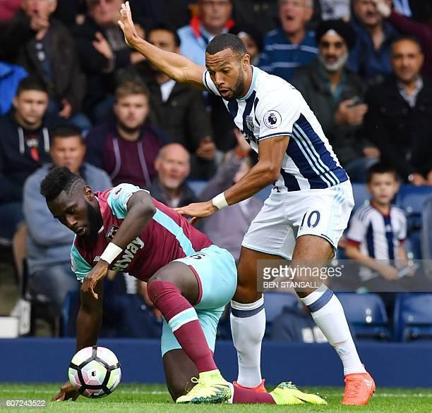 West Bromwich Albion's Englishborn Scottish midfielder Matt Phillips vies for the ball with West Ham United's French defender Arthur Masuaku during...