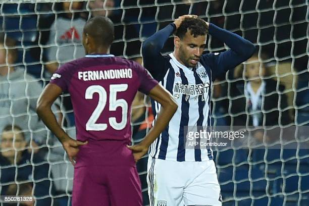 West Bromwich Albion's Englishborn Welsh striker Hal RobsonKanu reacts after missing a great chance late on in the English League Cup third round...
