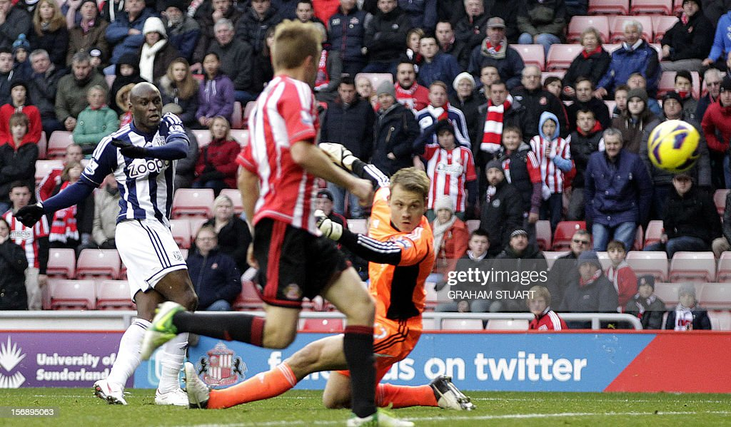 """West Bromwich Albion's French striker Marc-Antonie Fortune (L) scores his team's fourth goal against Sunderland during their English Premier League football match at the Stadium of Light in Sunderland, north-east England, on November 24, 2012. USE. No use with unauthorized audio, video, data, fixture lists, club/league logos or """"live"""" services. Online in-match use limited to 45 images, no video emulation. No use in betting, games or single club/league/player publications"""